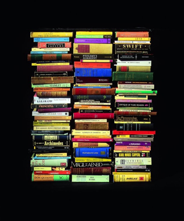 a stack of books against a dark background